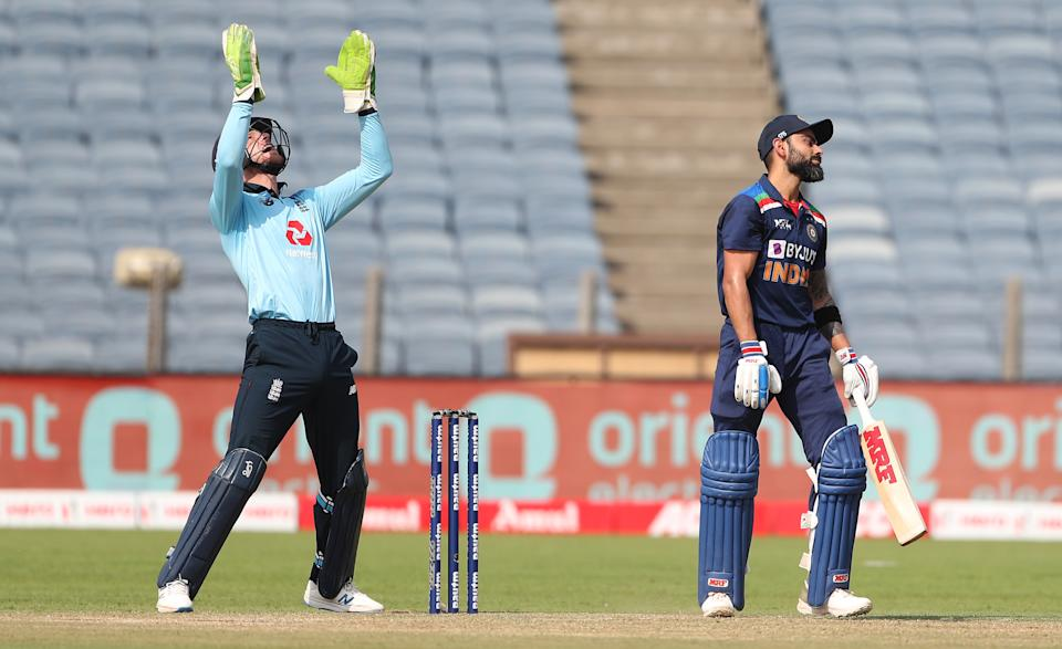 PUNE, INDIA - MARCH 26: England wicketkeeper Jos Buttler celebrates after catching out India batsman Virat Kohli off the bowling of Adil Rashid during the 2nd One Day International between India and England at MCA Stadium on March 26, 2021 in Pune, India. (Photo by Surjeet Yadav/Getty Images)