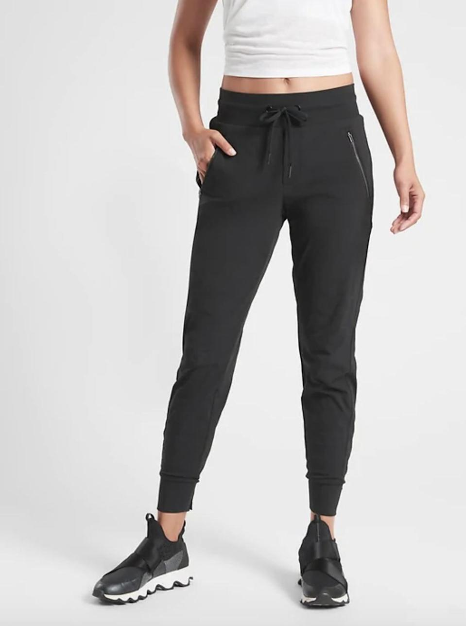 """<p>""""Over the last three months, I have been living in athleisure (this is no exaggeration). For summer, I wanted to wear something that would elevate my daily leggings uniform into something a little more chic. I've been loving the super comfy <a href=""""https://www.popsugar.com/buy/Athleta-Trekkie-North-Jogger-578965?p_name=Athleta%20Trekkie%20North%20Jogger&retailer=athleta.gap.com&pid=578965&price=89&evar1=fit%3Auk&evar9=47513257&evar98=https%3A%2F%2Fwww.popsugar.com%2Ffitness%2Fphoto-gallery%2F47513257%2Fimage%2F47522240%2FAthleta-Trekkie-North-Jogger&list1=healthy%20living&prop13=api&pdata=1"""" class=""""link rapid-noclick-resp"""" rel=""""nofollow noopener"""" target=""""_blank"""" data-ylk=""""slk:Athleta Trekkie North Jogger"""">Athleta Trekkie North Jogger</a> ($89). I have the black pair, and they look great with white sneakers and a plain white T-shirt."""" - Christina Stiehl, senior editor, Fitness</p>"""