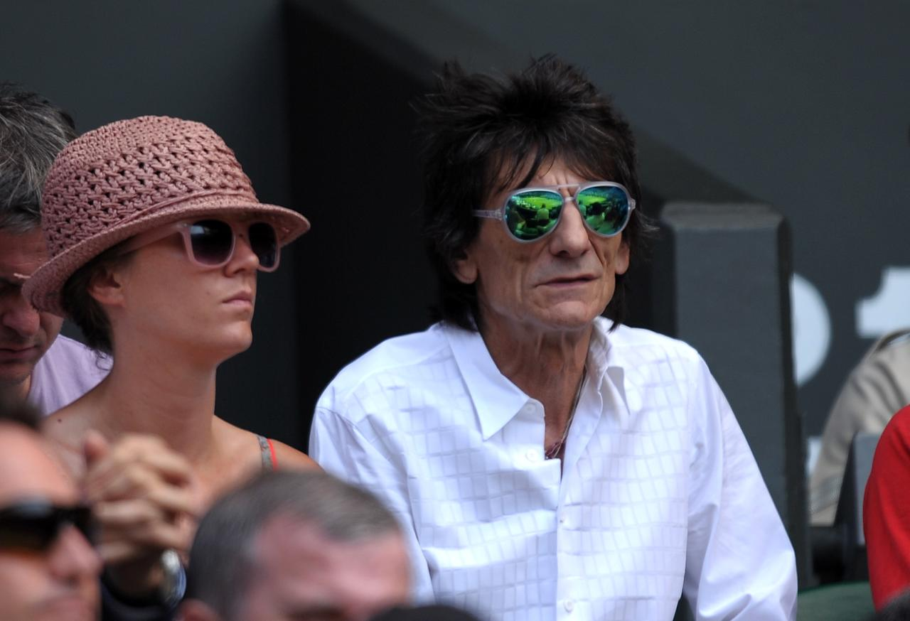 Ronnie Wood watches Great Britain's Andy Murray against Serbia's Novak Djokovic in the stands on day thirteen of the Wimbledon Championships at The All England Lawn Tennis and Croquet Club, Wimbledon.