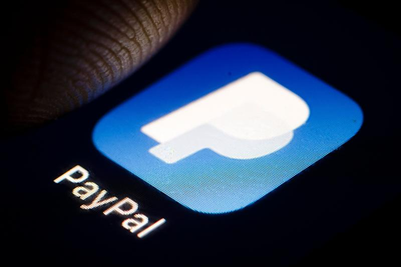 BERLIN, GERMANY - DECEMBER 14: The Logo of worldwide online payments system PayPal is displayed on a smartphone on December 14, 2018 in Berlin, Germany. (Photo by Thomas Trutschel/Photothek via Getty Images)