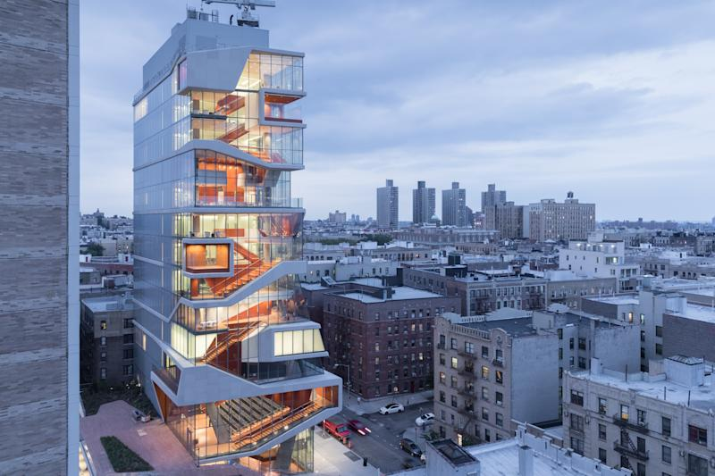 """Columbia University's Roy and Diana Vagelos Education Center, completed in 2016, achieves a """"continuous surface building"""" in which a single concrete ribbon serves as walls, ceilings, and floors."""