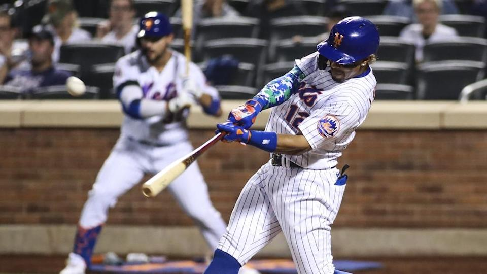 Sep 12, 2021; New York City, New York, USA; New York Mets shortstop Francisco Lindor (12) hits his third home run of the game in the eighth inning against the New York Yankees at Citi Field.