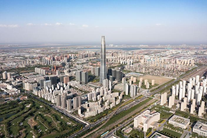 <p><strong>Location:</strong> Tianjin, China</p><p><strong>Height:</strong> 1,739 feet </p><p><strong>Completion date: </strong>September 2019</p><p>The groundbreaking ceremony for the Tianjin CTF center took place in November 2009. The building features a curved glass look which was accomplished by using eight massive, strategically placed columns that provide support and stability and are designed to help keep the building upright in the event of an earthquake or other seismic activity. The taper seen on the edifice not only looks cool but also helps minimize the amount of surface area exposed to the elements. The Tianjin CTF center is easy to spot if you ever find yourself in the city—it towers over the surrounding buildings in the area.<br></p><p><em><strong>Honorable mention:</strong> The Guangzhou Chow Tai Fook Finance Center (s<em>ometimes referred to as the CTF Finance Center)</em> in Guangzhou, China is also 1,739 feet tall.</em></p>