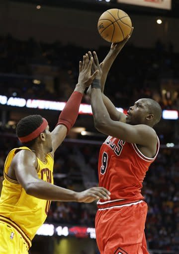 Chicago Bulls' Luol Deng (9) shoots over Cleveland Cavaliers' C.J. Miles during the second quarter of an NBA basketball game Friday, Nov. 2, 2012, in Cleveland. (AP Photo/Mark Duncan)
