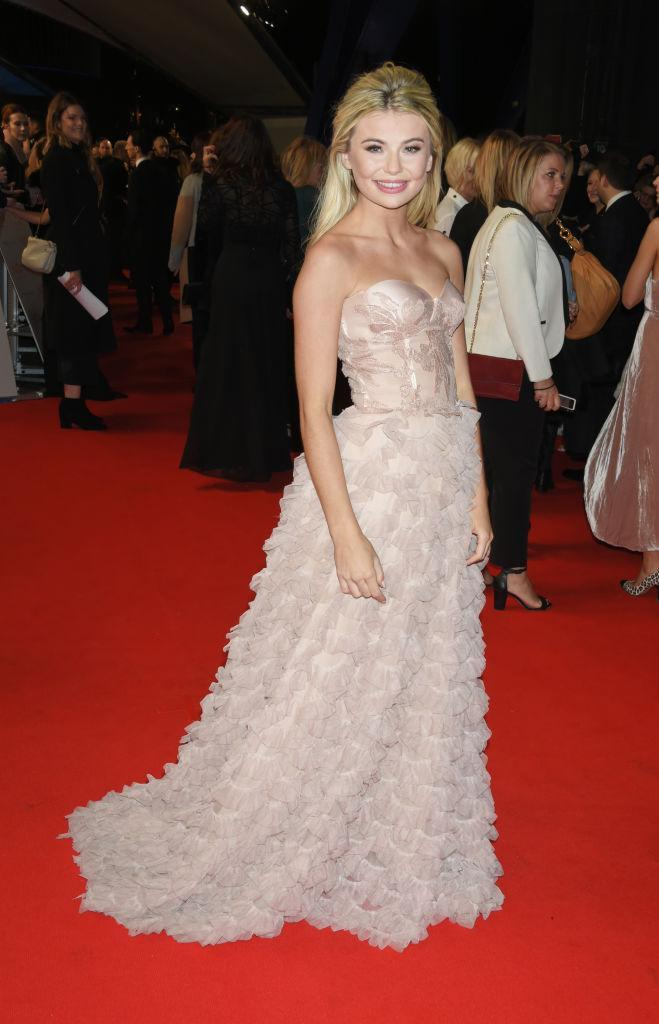 <p>Georgia Toffolo (AKA, Toff) donned a cold-shoulder gown complete with a ruffled skirt for the awards ceremony. <em>[Photo: Getty]</em> </p>
