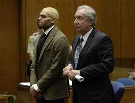 Singer Chris Brown (L) and his attorney Mark Geragos appear in court during a probation violation hearing in which his probation was revoked in Los Angeles Superior Court in Los Angeles, December 16, 2013. REUTERS/ Kevork Djansezian/Pool