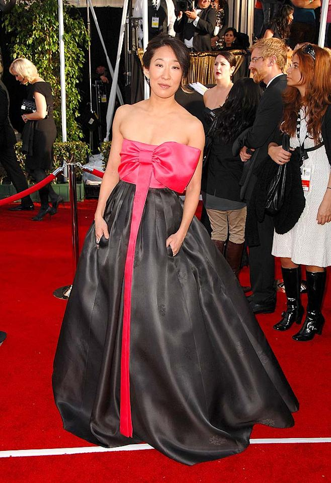 "Oh N'Oh she didn't?! ""Grey's Anatomy"" co-star Sandra Oh delivers a hideous package to the red carpet in the form of her unflattering frock. Once opened, that wrapping needs to be trashed. Steve Granitz/<a href=""http://www.wireimage.com"" target=""new"">WireImage.com</a> - January 27, 2008"