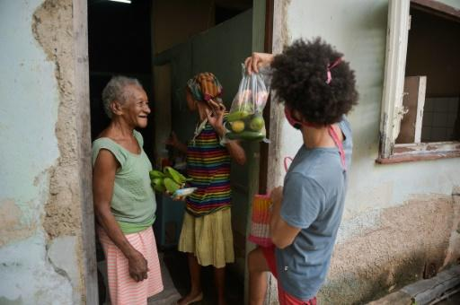 Olga and Carmen More look forward to visits from young Cubans who deliver food to the elderly in their neigborhood
