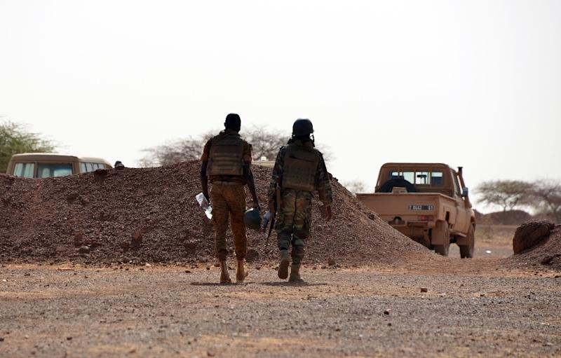 Burkina Faso soldiers patrol near Tambao mine in Tambao, 350 kilometers (220 miles) northeast of the capital, Ouagadougou on April 5, 2015, where five armed men attacked a manganese mine and kidnapped a Romanian mineworker the day before