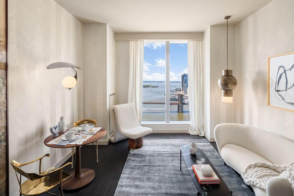 <p>Inspired by a couple whose children have left home, this residence offers relaxation and proximity to city sights. In the calming living room, contemporary art mixes with neutral upholstery.</p>