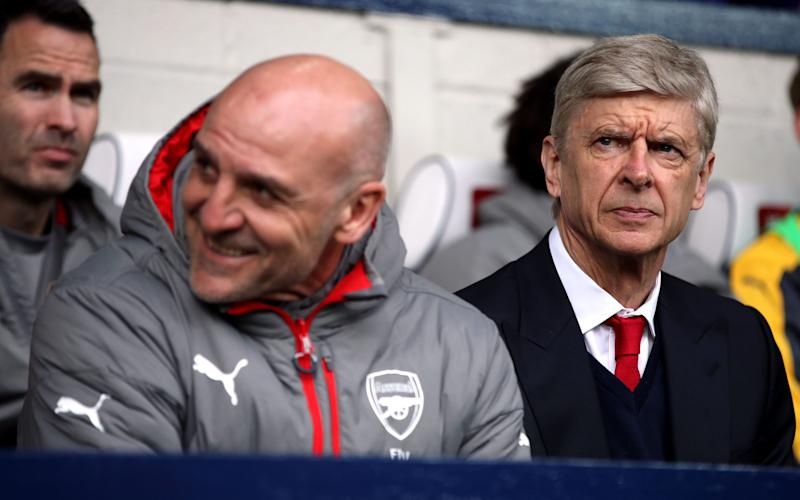 Arsenal manager Arsene Wenger and his assistant Steve Bould during the Premier League match at The Hawthorns, West Bromwich