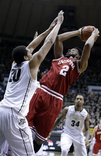 Indiana forward Christian Watford, right, shoots over Indiana guard Taylor Wayer during the first half of an NCAA college basketball game in West Lafayette, Ind., Wednesday, Jan. 30, 2013. (AP Photo/Michael Conroy)