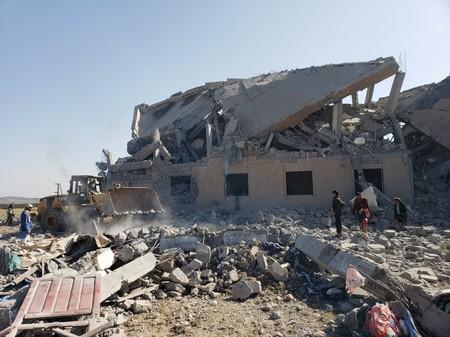 People search among the rubble at the site of Saudi-led air strikes on a Houthi detention centre in Dhamar