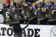 Vegas Golden Knights defenseman Nick Holden (22) celebrates after scoring against the Montreal Canadiens during the third period in Game 1 of an NHL hockey Stanley Cup semifinal playoff series Monday, June 14, 2021, in Las Vegas. (AP Photo/John Locher)