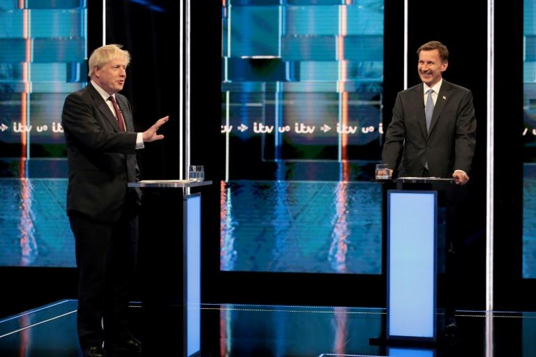 Johnson, left, and Hunt, shown here in their last debate, both refer to Britain's departure with no overall deal in place as a realistic prospect