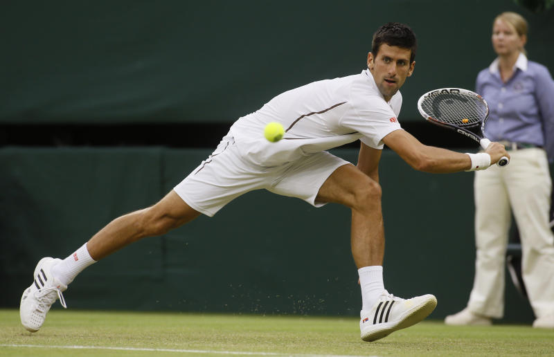 Novak Djokovic of Serbia plays a return to Bobby Reynolds of the United States during their Men's second round singles match at the All England Lawn Tennis Championships in Wimbledon, London, Thursday, June 27, 2013. (AP Photo/Kirsty Wigglesworth)