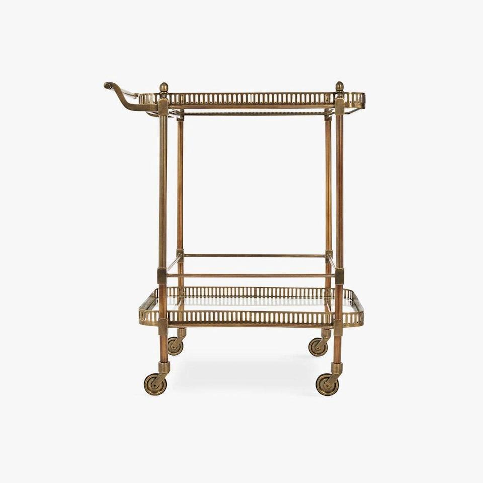"""Can't get a membership at Soho House? You <em>can</em> get this bar cart, from Soho Home, and a variety of other design-forward homeware from the private club group. Call it a trolley for added flair. $645, SOHO HOME. <a href=""""https://www.sohohome.com/us/products/drinks-trolley-brass/75767448"""" rel=""""nofollow noopener"""" target=""""_blank"""" data-ylk=""""slk:Get it now!"""" class=""""link rapid-noclick-resp"""">Get it now!</a>"""
