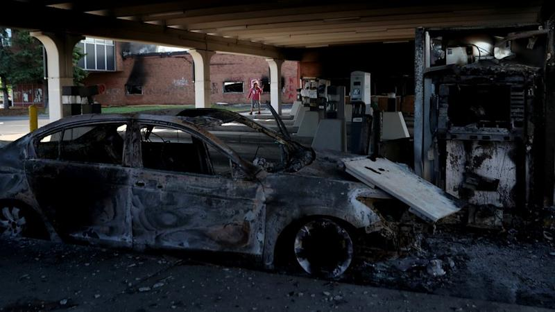 A burnt vehicle in the aftermath of protests in Minneapolis, Minnesota, 30 May 2020