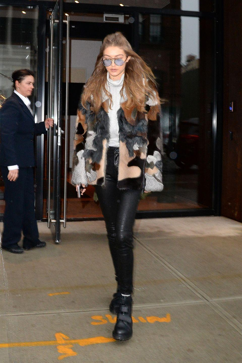 <p>In a patterned fur coat, n : PHILANTROPY grey turtleneck sweater, leather pants, Velcro Doc Martens combat boots and blue tinted aviators while out in NYC. </p>