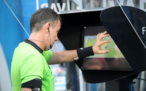 Referee Joel Aguilar reviews the VAR footage, before awarding Sweden a penalty during the 2018 FIFA World Cup Russia group F match between Sweden and Korea Republic at Nizhniy Novgorod Stadium on June 18, 2018 in Nizhniy Novgorod, Russia - Credit: Getty Images