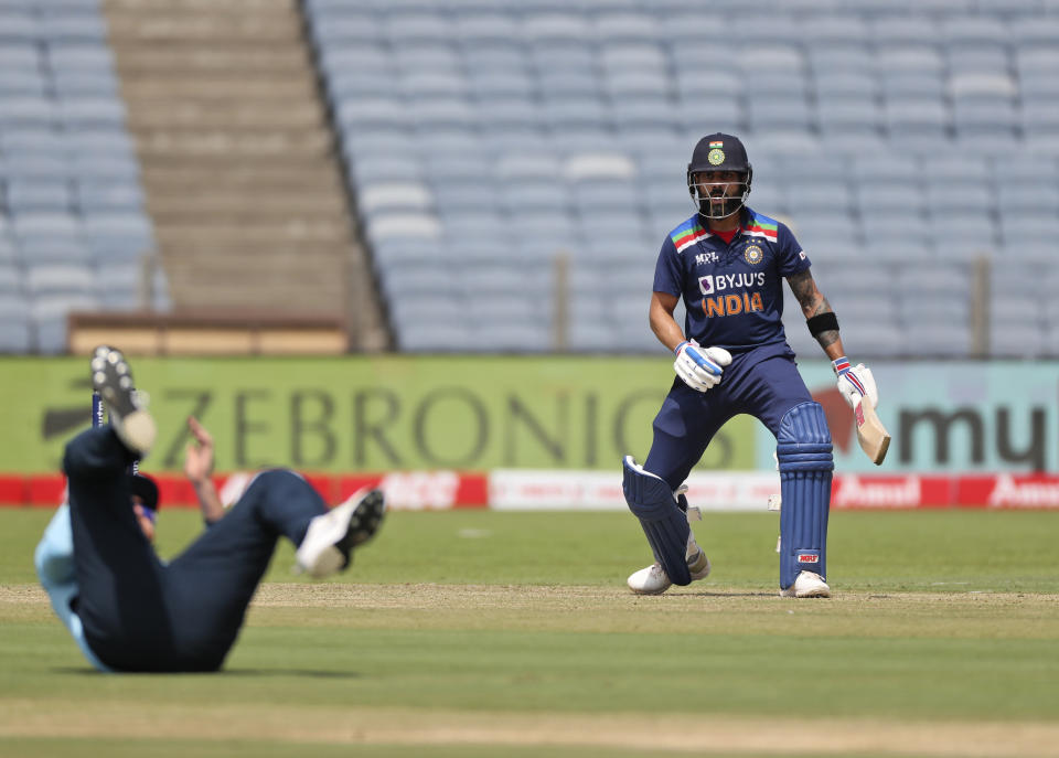 India's Virat Kohli follows the ball after playing a shot during the second one-day international cricket match between India and England in Pune, India, Friday, March 26, 2021. (AP Photo/Rafiq Maqbool)