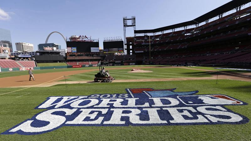 Grounds crew workers prepare the field before a baseball practice, Friday, Oct. 25, 2013, in St. Louis. The St. Louis Cardinals and Boston Red Sox are set to play Game 3 of the World Series on Saturday in St. Louis. (AP Photo/Charlie Neibergall)