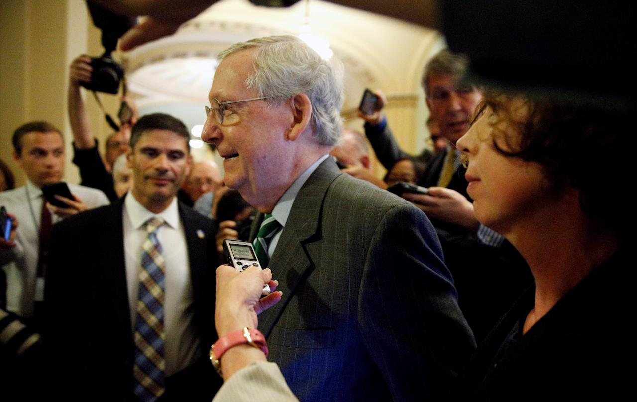 Senator Majority Leader Mitch McConnell is trailed by reporters as he walks to the Senate floor of the U.S. Capitol after unveiling a draft bill on healthcare in Washington, U.S., June 22, 2017. REUTERS/Kevin Lamarque