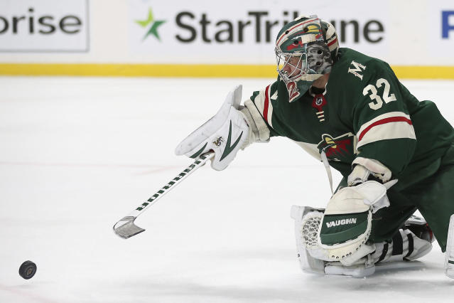 Minnesota Wild's goalie Alex Stalock blocks a shot attempt by the Philadelphia Flyers in the second period of an NHL hockey game Saturday Dec. 14, 2019, in St. Paul, Minn. (AP Photo/Stacy Bengs)