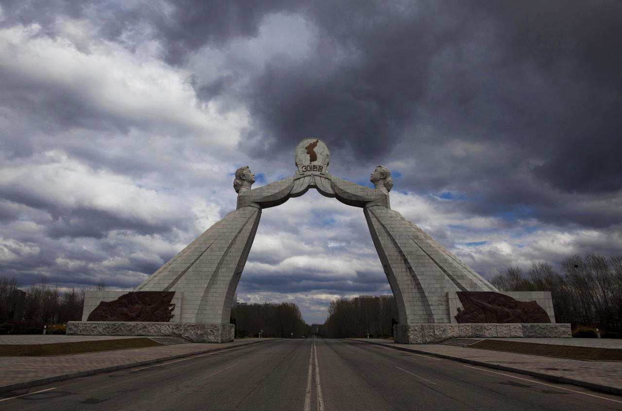 FILE - A statue known as the Monument to the Three Charters for National Reunification, which symbolizes the hope for eventual reunification of the two Koreas, arches over a highway at the edge of Pyongyang, North Korea, on April 18, 2011. (AP Photo/David Guttenfelder, File)