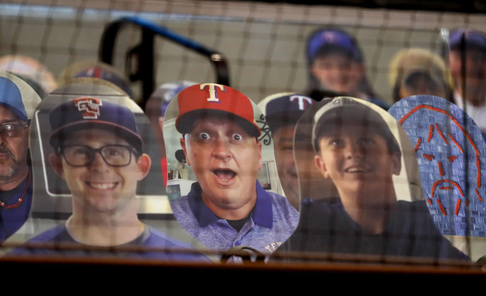 Cutout photos of people are set up in the stands at Globe Life Field in Arlington, Texas, Thursday, July 23, 2020, in preparation the Texas Rangers opening day baseball game. The Rangers host the Colorado Rockies on Friday. (AP Photo/LM Otero)
