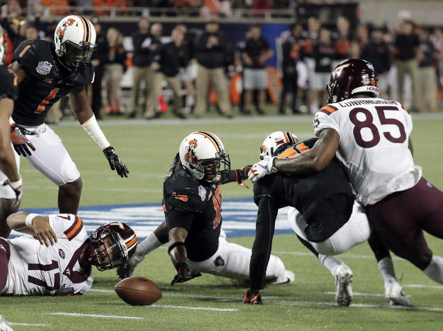 "Virginia Tech quarterback <a class=""link rapid-noclick-resp"" href=""/ncaaf/players/264245/"" data-ylk=""slk:Josh Jackson"">Josh Jackson</a> (17) watches a fumble, along with Oklahoma State linebacker <a class=""link rapid-noclick-resp"" href=""/ncaaf/players/242777/"" data-ylk=""slk:Justin Phillips"">Justin Phillips</a>, center, and safety Tre Flowers, second from right, as Virginia Tech tight end <a class=""link rapid-noclick-resp"" href=""/ncaaf/players/257004/"" data-ylk=""slk:Chris Cunningham"">Chris Cunningham</a> (85) comes in to help during the first half of the Camping World Bowl NCAA college football game, Thursday, Dec. 28, 2017, in Orlando, Fla. Oklahoma State recovered the fumble. (AP Photo/John Raoux)"
