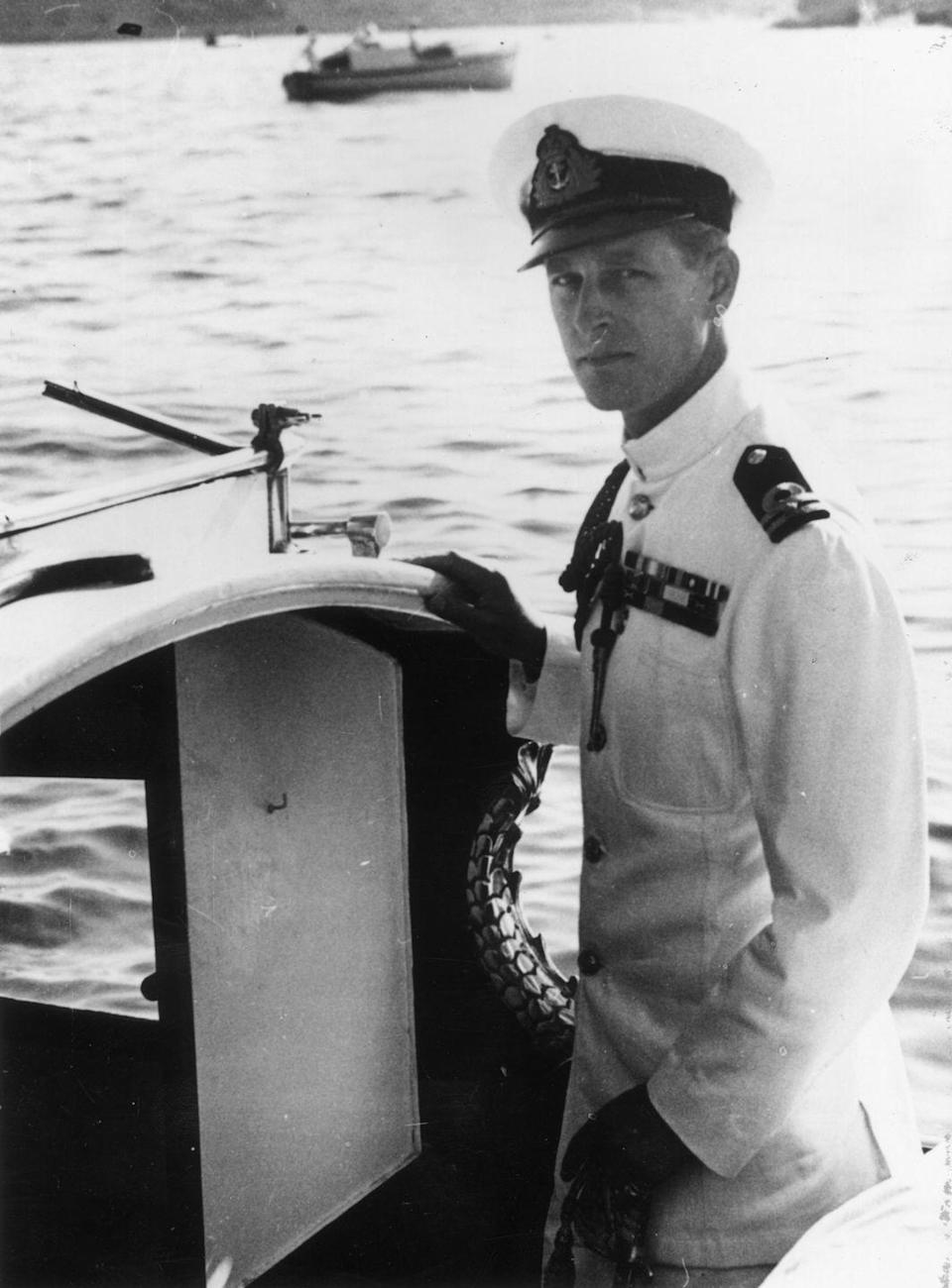<p>Prince Philip in his naval uniform on a boat in Malta, pictured in October 1948. </p>