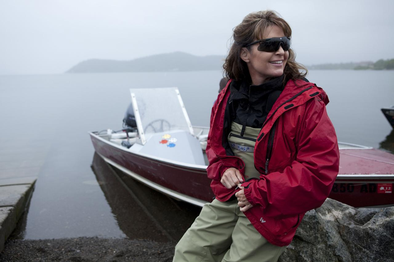"** ADVANCE FOR SUNDAY, NOV. 14**   In this photo taken July 2, 2010 and provided by the Discovery Communications, Sarah Palin waits by her husband Todd's boat before heading up river to see fish being counted in Dillingham, Alaska as part of a documentary for the TLC channel. ""Sarah Palin's Alaska"" is fairly accurate with the facts about her home state. But more spot on is the title of the upcoming TLC documentary series. It's definitely Palin's Alaska, if not anyone else's. The first episode, airing Sunday, portrays the state with a sweeping grandeur not so readibly accessible for Alaskans with less time and money than the former Alaska governor and 2008 Republican vice presidential nominee. (AP Photo/Discovery Communications, Gilles Mingasson)  NO SALES"