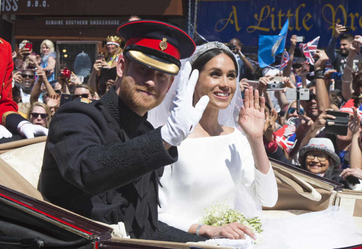 """January 20th 2020 - Buckingham Palace has announced that Prince Harry and Duchess Meghan will no longer use """"royal highness"""" titles and will not receive public money for their royal duties. Additionally, as part of the terms of surrendering their royal responsibilities, Harry and Meghan will repay the $3.1 million cost of taxpayers' money that was spent renovating Frogmore Cottage - their home near Windsor Castle. - January 9th 2020 - Prince Harry The Duke of Sussex and Duchess Meghan of Sussex intend to step back their duties and responsibilities as senior members of the British Royal Family. - File Photo by: zz/KGC-03/STAR MAX/IPx 2018 5/19/18 Prince Harry The Duke of Sussex and Meghan Markle The Duchess of Sussex - man and wife - at their wedding ceremony held at St. George's Chapel on the grounds of Windsor Castle. (Windsor, England, UK)"""