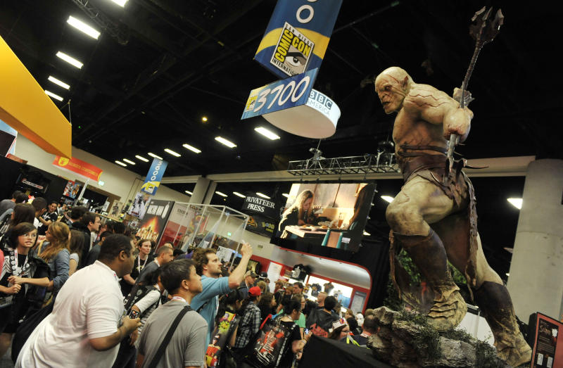 A model looms over Comic-Con attendees during the Preview Night event on Day 1 of the 2013 Comic-Con International Convention on Wednesday, July 17, 2013 in San Diego, Calif. (Photo by Chris Pizzello/Invision/AP)