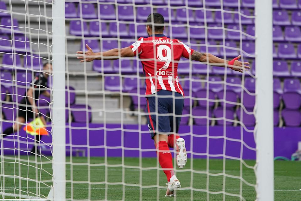 Atletico Madrid's Uruguayan forward Luis Suarez celebrates after scoring during the Spanish league football match Real Valladolid FC against Club Atletico de Madrid at the Jose Zorilla stadium in Valladolid on May 22, 2021. (Photo by CESAR MANSO / AFP) (Photo by CESAR MANSO/AFP via Getty Images)
