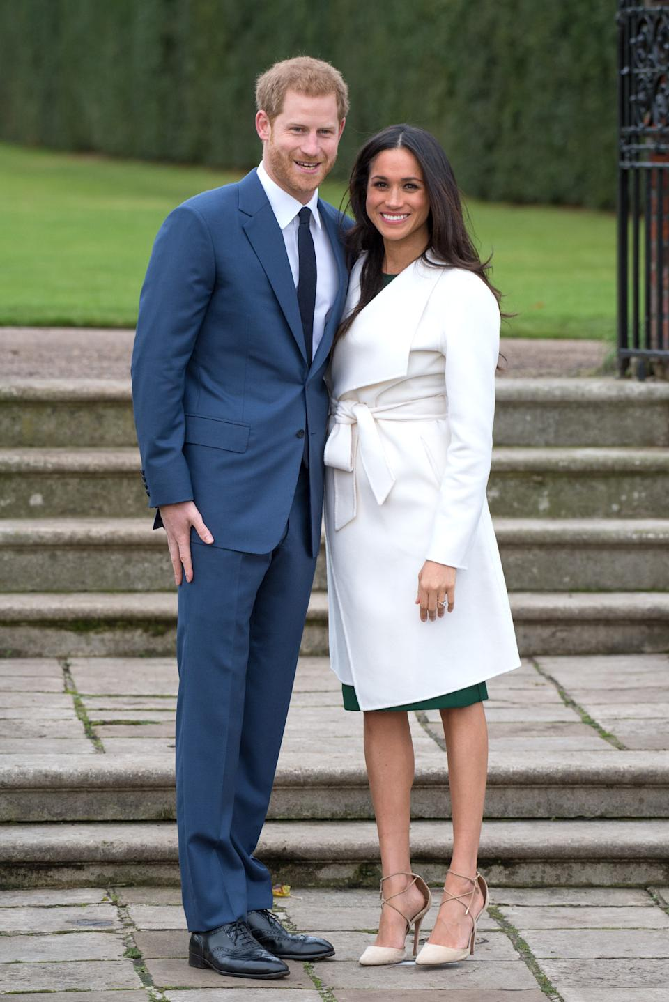 Just over one year later in November 2018, Markle wore a white belted coat by Canadian brand Line The Label during her and Prince Harry's photo-call announcing their engagement to the public. (Photo: Getty Images)