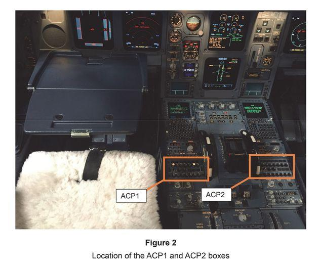 A photo issued by the AAIB of the console from the cockpit of a Airbus A330 showing the Audio Control Panels which were damaged when a pilot spilled coffee