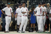 National League's Nolan Arenado, of the St. Louis Cardinals, center, warms-up during batting practice prior to the MLB All-Star baseball game, Tuesday, July 13, 2021, in Denver. (AP Photo/Gabriel Christus)