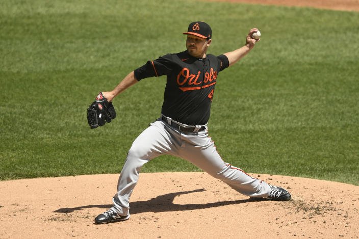 Baltimore Orioles starter Keegan Akin delivers a pitch during the first inning of a baseball game against the Chicago White Sox Sunday, May 30, 2021, in Chicago. (AP Photo/Paul Beaty)