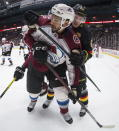 Vancouver Canucks' Bo Horvat, back right, checks Colorado Avalanche's Pierre-Edouard Bellemare, of France, during the second period of an NHL hockey game Saturday, Nov. 16, 2019, in Vancouver, British Columbia. (Darryl Dyck/The Canadian Press via AP)