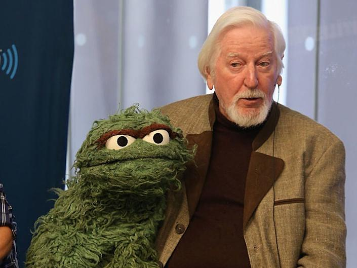 Sesame Street puppeteer Caroll Spinney, with Oscar the Grouch, in 2014: Robin Marchant/Getty Images for SiriusXM