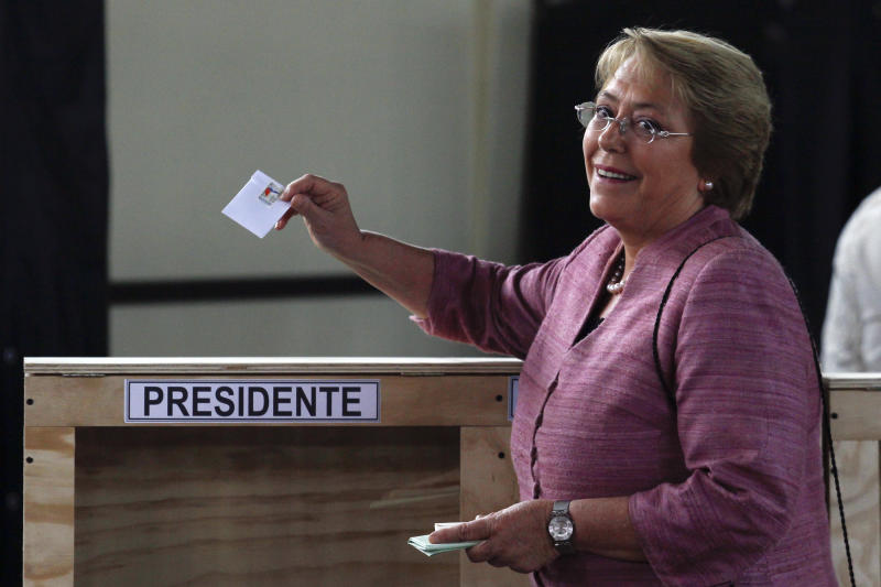 Chile's former President Michelle Bachelet casts her vote during Chile's general elections in Santiago, Chile, Sunday, Nov. 17, 2013. Bachelet is the front runner and conservative Evelyn Matthei is a distant second in Sunday's election for Chile's presidency. Seven other candidates could push the vote into a Dec. 15 runoff. (AP Photo/Luis Hidalgo)