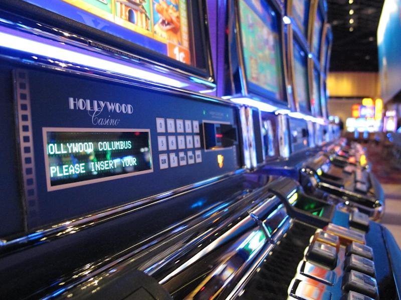 Slot machines sit ready as the Hollywood Casino Columbus opens on Oct. 8, 2012, in Columbus, Ohio.  The $400 million Hollywood Casino Columbus is expected to draw 3 million visitors annually.  (AP Photo/Kantele Franko.)