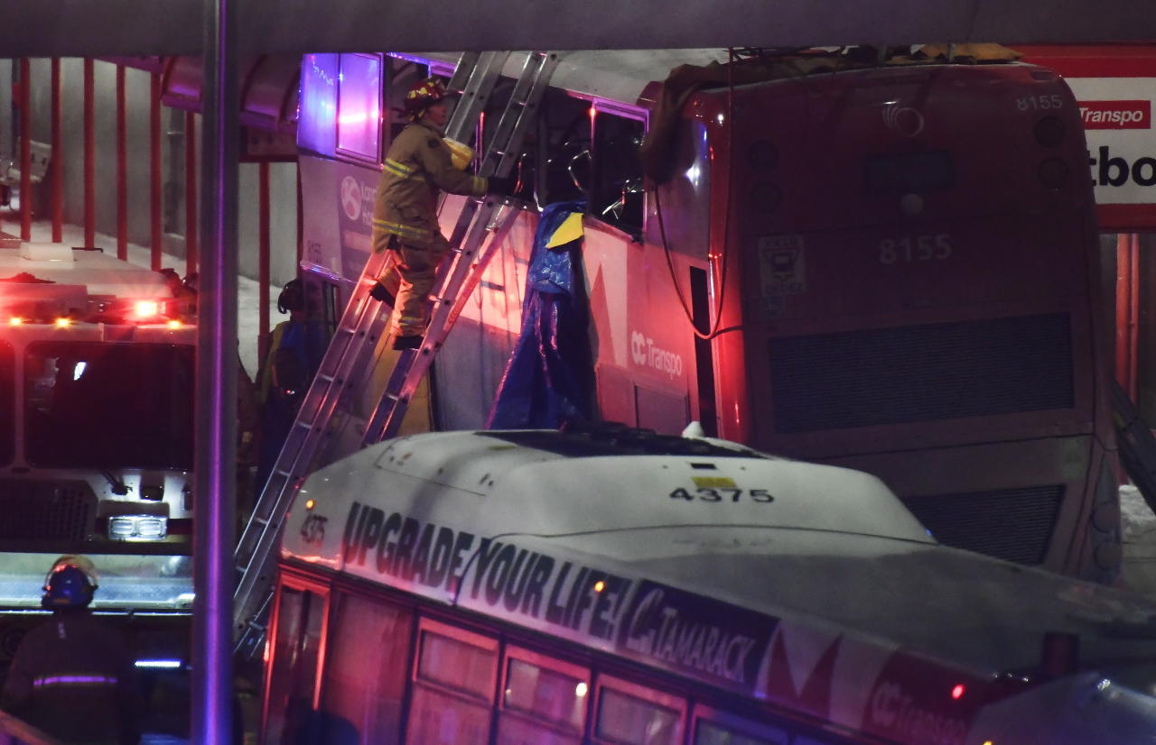 <p>Police and first responders work at the scene where a double-decker city bus struck a transit shelter in Ottawa, on Friday, Jan. 11, 2019. Multiple people have died, with dozens injured. (The Canadian Press) </p>