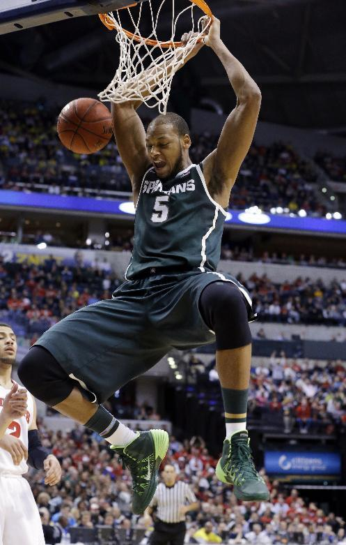 Michigan State forward Adreian Payne dunks in the first half of an NCAA college basketball game against Wisconsin in the semifinals of the Big Ten Conference tournament Saturday, March 15, 2014, in Indianapolis. (AP Photo/Michael Conroy)