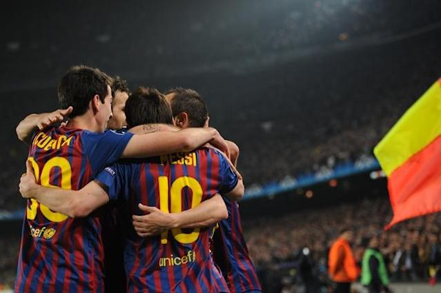 AC Milan players celebrate after the second penalty scored by Lionel Messi during the Champions League quarter-final second leg football match FC Barcelona vs AC Milan on April 3, 2012 at Camp Nou stadium in Barcelona. FC Barcelona defeated AC Milan 3-1 to reach the semi-finals. AFP PHOTO / LLUIS GENE