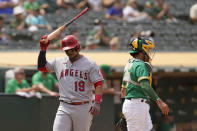 Los Angeles Angels' Juan Lagares reacts after striking out swinging against Oakland Athletics relief pitcher Lou Trivino in the ninth inning of a baseball game Wednesday, June 16, 2021, in Oakland, Calif. At right is Oakland Athletics catcher Aramis Garcia. (AP Photo/Eric Risberg)