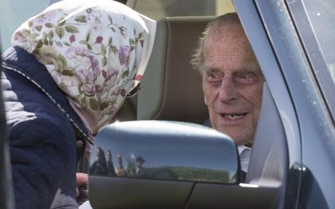 Queen Elizabeth II talks to Prince Philip, Duke of Edinburgh in his car at the Royal Windsor Horse Show  - Credit: Mark Cuthbert /UK Press