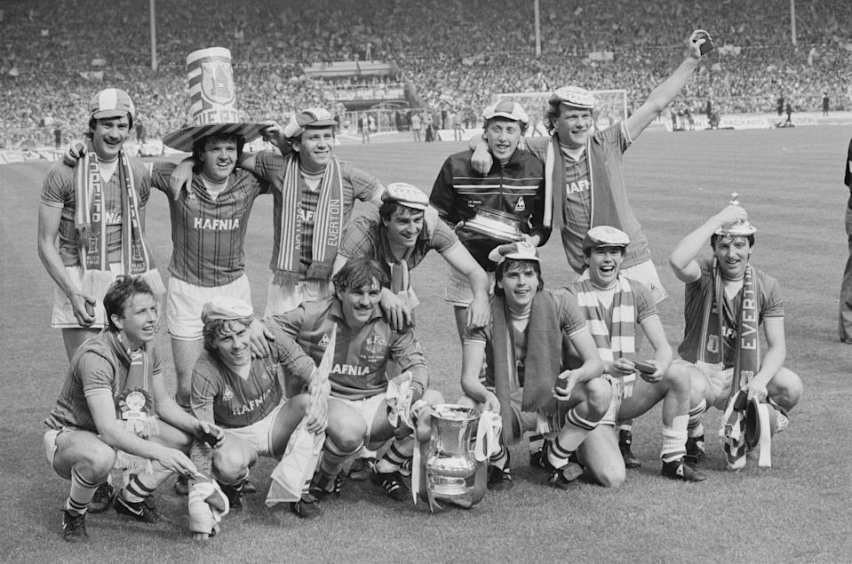 Graeme Sharp, front row third from right, celebrates with Everton teammatesGetty Images